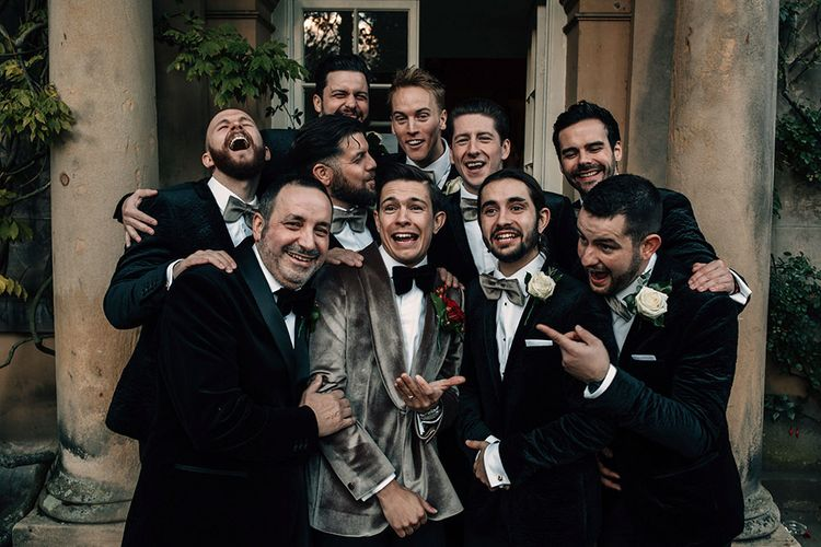 Groomsmen in Tuxedos with Groom in Grey Velvet Dinner Jacket