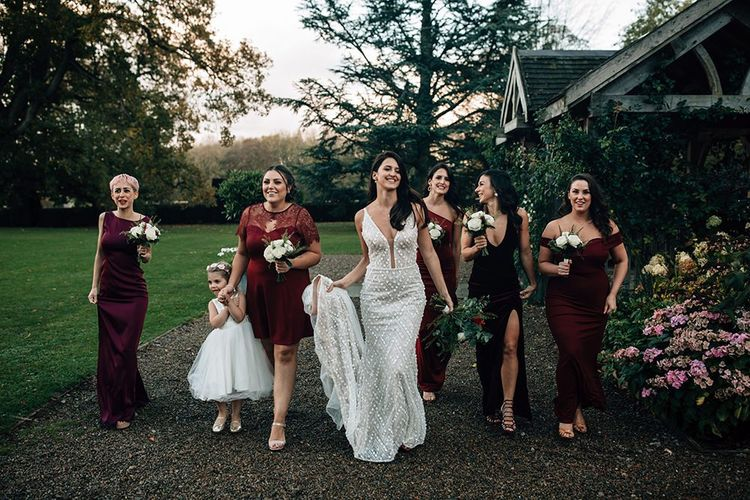 Bridal Party Portrait with Bridesmaids in Burgundy Dresses and Bride in Embellished Wedding Dress
