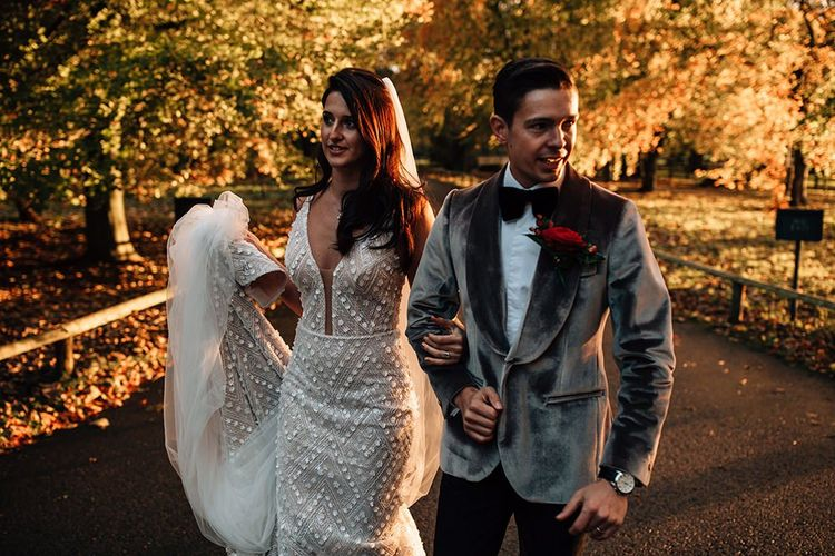 Golden Hour Portrait with Groom in Grey Velvet Dinner Jacket and Bride in Crystal Design Wedding Dress
