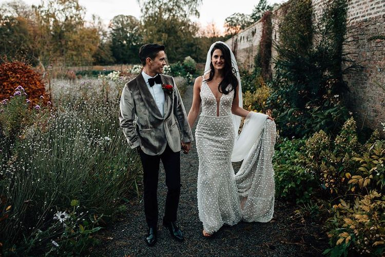 Hollywood Glamour Bride and Groom in Embellished Wedding Dress and Grey Velvet Dinner Jacket