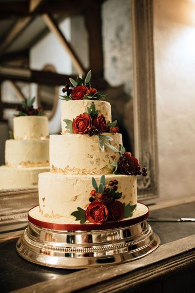 Buttercream Wedding Cake with Gold Leaf Decor and Red Roses
