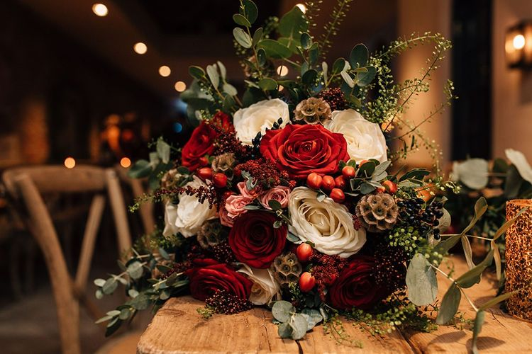 Red and White Rose Wedding Bouquet with Foliage