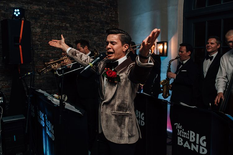 Groom in Grey Velvet Tuxedo Jacket Performing at the Evening Reception