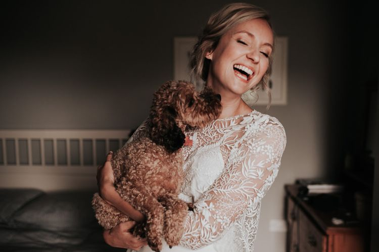 Bride in Two Piece Wedding Gown with Pet at Wedding