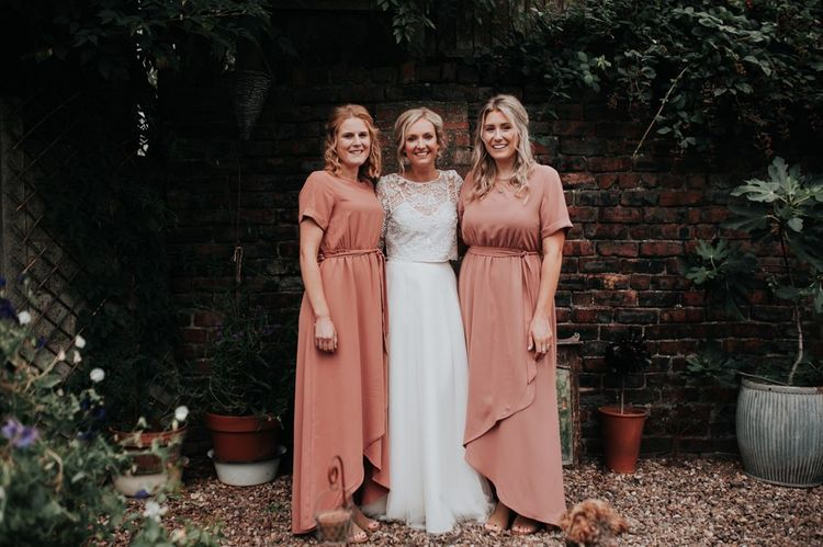 Bride in Two Piece Gown with Blush Bridesmaid Dresses