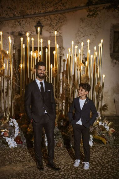 Groom in Hugo Boss Suit and Son at the Wedding Lighting Altar