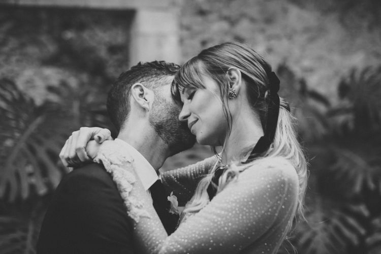 Groom Kissing His Brides Neck