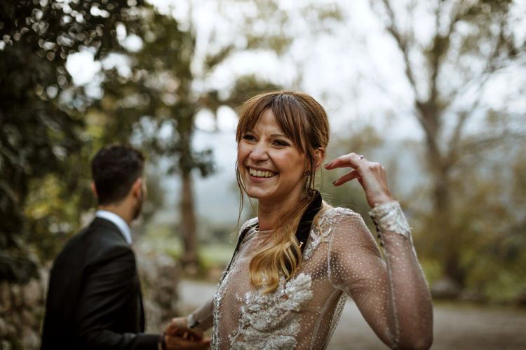 Beautiful Bride with Fringe and Pony Tail in Long Sleeve Dress