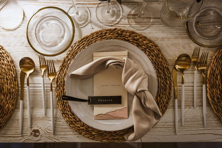 Place Setting with Wicker Place Mat, White Cutlery and Modern Stationery