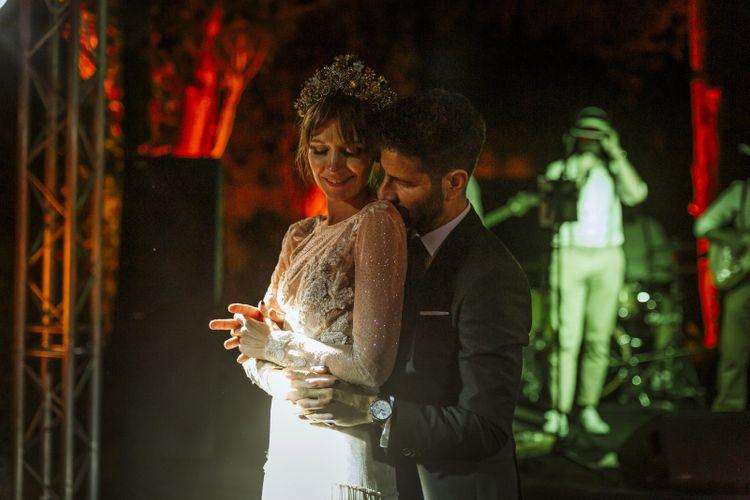 Groom Kissing His Bride Shoulder in a Bridal Crown