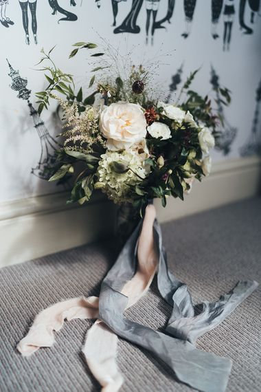 Bridal Bouquet with White Flowers, Foliage and Grey and Pink Trailing Ribbons | Metallic Confetti Cannons and Paper Lanterns with Bride in Beaded Shoulder Eliza Jane Howell Dress | Miss Gen Photography