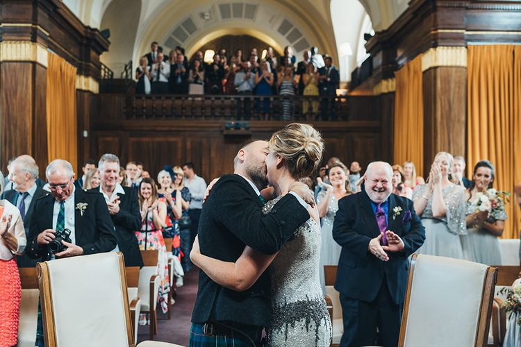 Bride in Embellished Shoulder Sequin Dress with Drop Waist by Eliza Jane Howell | Groom in Green and Blue Kilt | Wedding Ceremony at Stoke Newington Town Hall | Metallic Confetti Cannons and Paper Lanterns with Bride in Beaded Shoulder Eliza Jane Howell Dress | Miss Gen Photography