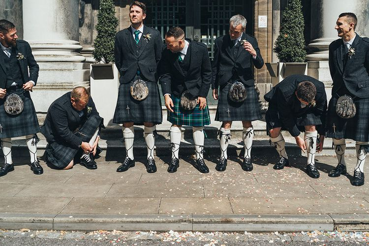 Groom in Green and Blue Tartan Kilt | Groomsmen in Grey Tartan Kilts | Metallic Confetti Cannons and Paper Lanterns with Bride in Beaded Shoulder Eliza Jane Howell Dress | Miss Gen Photography