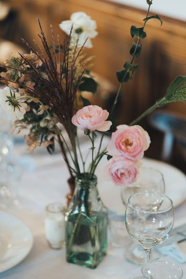 Bud Vase with Pink Flowers and Foliage | Wedding Reception at Clapton Country Club | Metallic Confetti Cannons and Paper Lanterns with Bride in Beaded Shoulder Eliza Jane Howell Dress | Miss Gen Photography