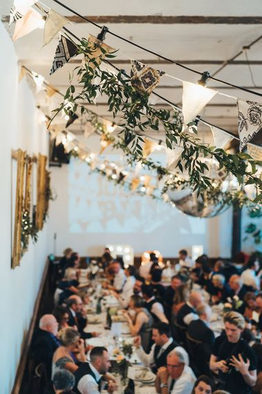 Hanging Foliage and Festoon Lights | Wedding Bunting | Glitter Ball | Letter Lights | Wedding Reception at Clapton Country Club | Metallic Confetti Cannons and Paper Lanterns with Bride in Beaded Shoulder Eliza Jane Howell Dress | Miss Gen Photography