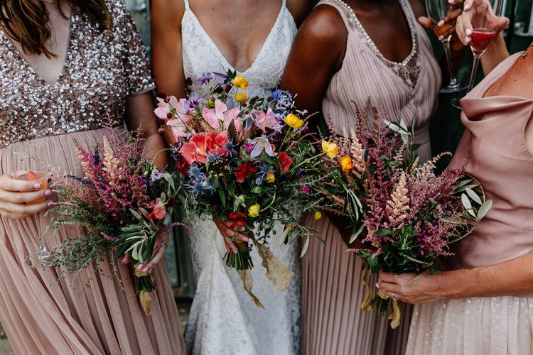 Bridesmaids in Dusky Pink Dresses Holding Pink Posies