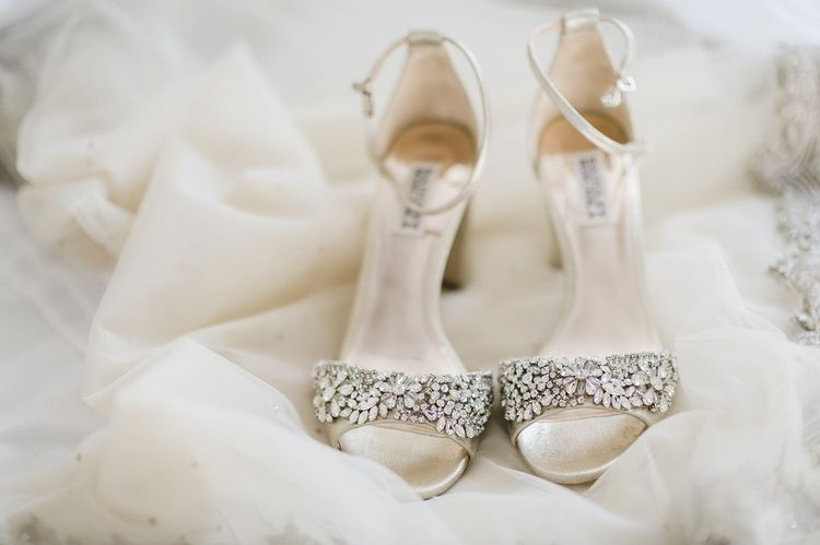 Bride shoes for multicultural wedding with red bridesmaid dresses