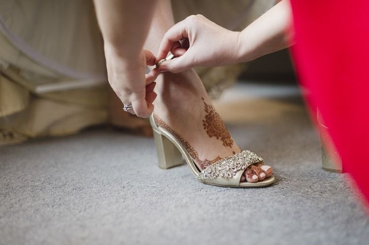 Gold wedding shoes with red bridesmaid dresses