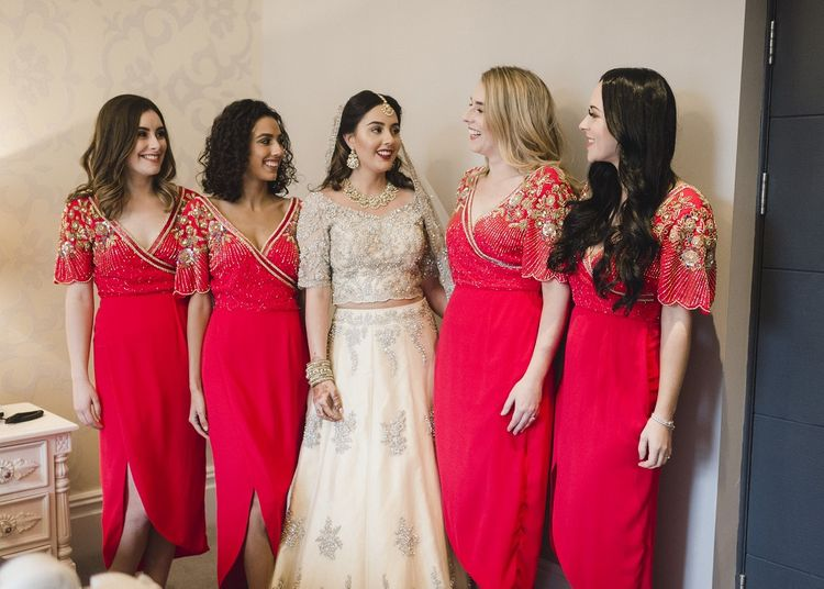 Bride with bridal party in red bridesmaid dresses
