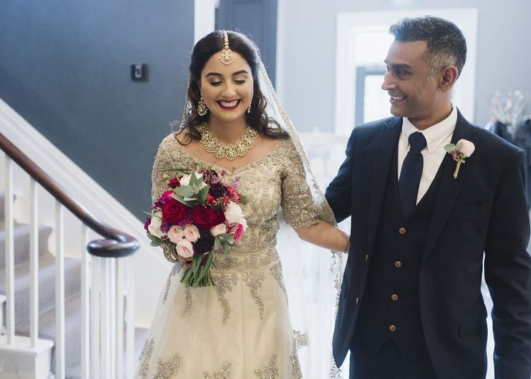 Bride with bright bouquet for wedding ceremony