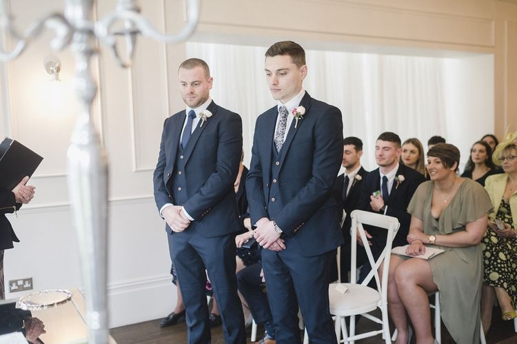 Groom waiting for bride at altar
