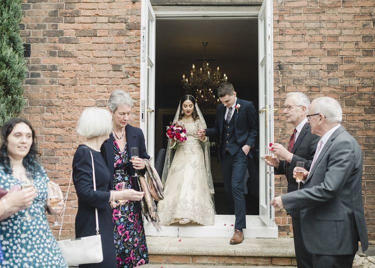 Confetti exit for bride and groom at hotel wedding venue