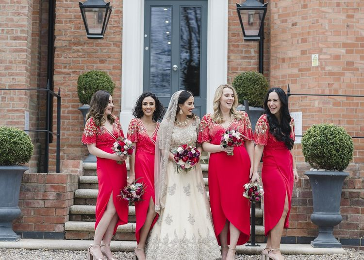Red bridesmaid dresses with bright flower bouquets