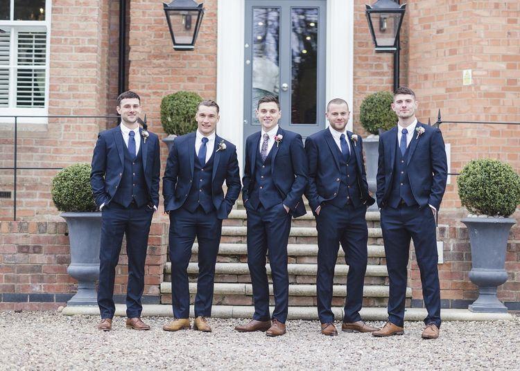 Groom and groomsmen in blue wedding suits