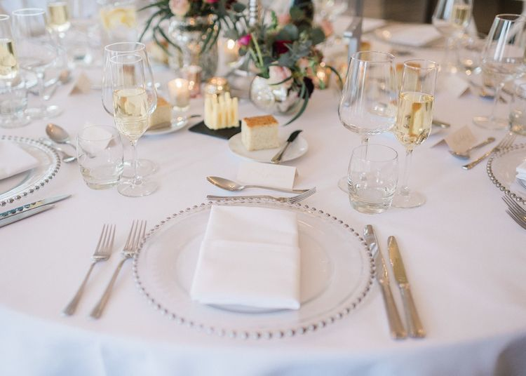 Wedding table decor at fusion wedding with red bridesmaid dresses