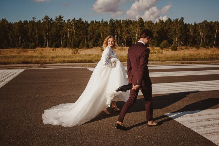 Bride In St Patrick Dress // Groom In Burgundy Suit // Exclusive Hire Wedding Venue In Nida Lithuania // Images By Motiejus