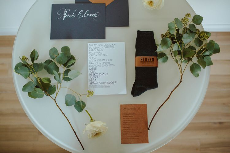 Wedding Stationery Flatlay // Groom In Burgundy Suit // Exclusive Hire Wedding Venue In Nida Lithuania // Images By Motiejus