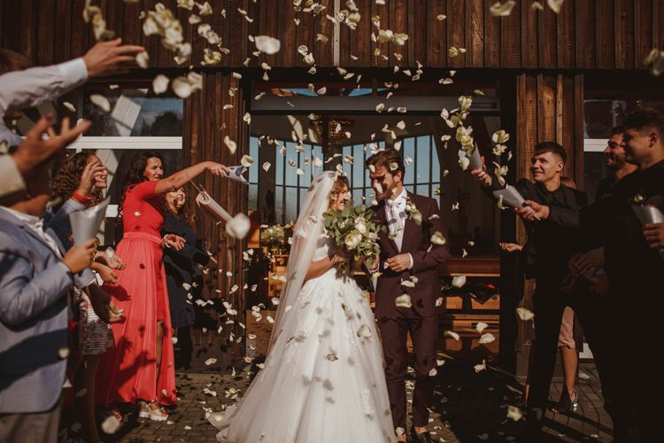 Confetti Shot // Bride In St Patrick // Groom In Burgundy Suit // Exclusive Hire Wedding Venue In Nida Lithuania // Images By Motiejus