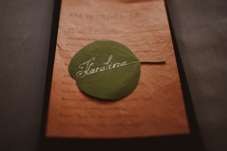 Hand Written Leaf Name Place For Wedding // Bride In St Patrick // Groom In Burgundy Suit // Exclusive Hire Wedding Venue In Nida Lithuania // Images By Motiejus