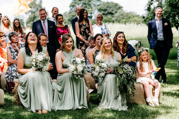 Bridesmaids In Sage Green Wrap Dresses // Bride In Floral Dress By Stephanie Allin Festival Wedding With Food Trucks & Outdoor Ceremony With Geo Dome Tent Baya Hire Epic Love Story Photography