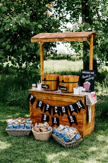 Popcorn Bar For Wedding // Bride In Floral Dress By Stephanie Allin Festival Wedding With Food Trucks & Outdoor Ceremony With Geo Dome Tent Baya Hire Epic Love Story Photography