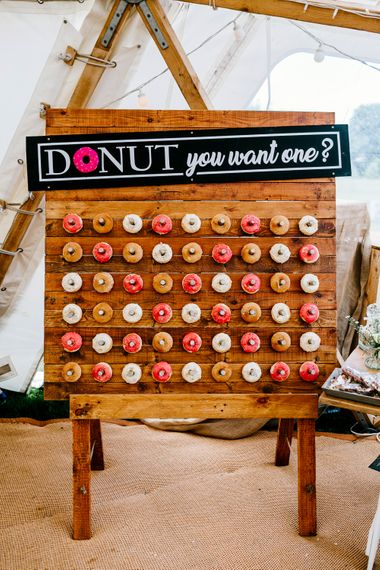 Donut Wall For Wedding // Bride In Floral Dress By Stephanie Allin Festival Wedding With Food Trucks & Outdoor Ceremony With Geo Dome Tent Baya Hire Epic Love Story Photography