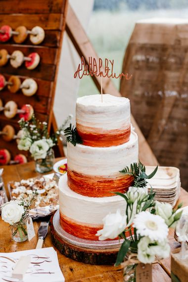 Bronze & White Wedding Cake With Cake Topper // Bride In Floral Dress By Stephanie Allin Festival Wedding With Food Trucks & Outdoor Ceremony With Geo Dome Tent Baya Hire Epic Love Story Photography
