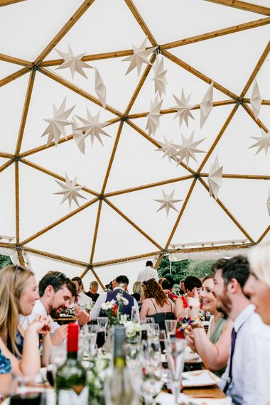 Star Lanterns For Wedding // Bride In Floral Dress By Stephanie Allin Festival Wedding With Food Trucks & Outdoor Ceremony With Geo Dome Tent Baya Hire Epic Love Story Photography