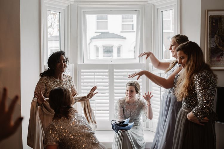 Bridesmaids In Sequinned Dresses // Christmas London Fields Brewery Wedding With Bride In Bespoke Dress By Katrine Mikklesen And Images From Taylor Hughes Photography