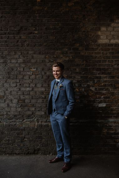 Groom In Navy Three Piece Suit // Christmas London Fields Brewery Wedding With Bride In Bespoke Dress By Katrine Mikklesen And Images From Taylor Hughes Photography