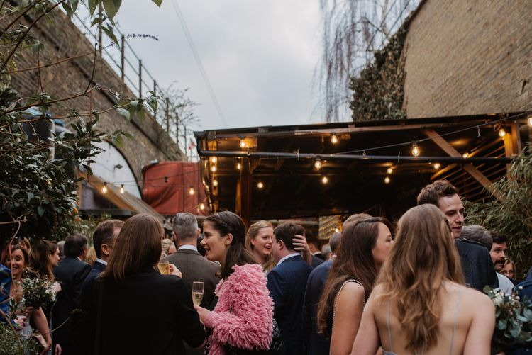 Christmas London Fields Brewery Wedding With Bride In Bespoke Dress By Katrine Mikklesen And Images From Taylor Hughes Photography