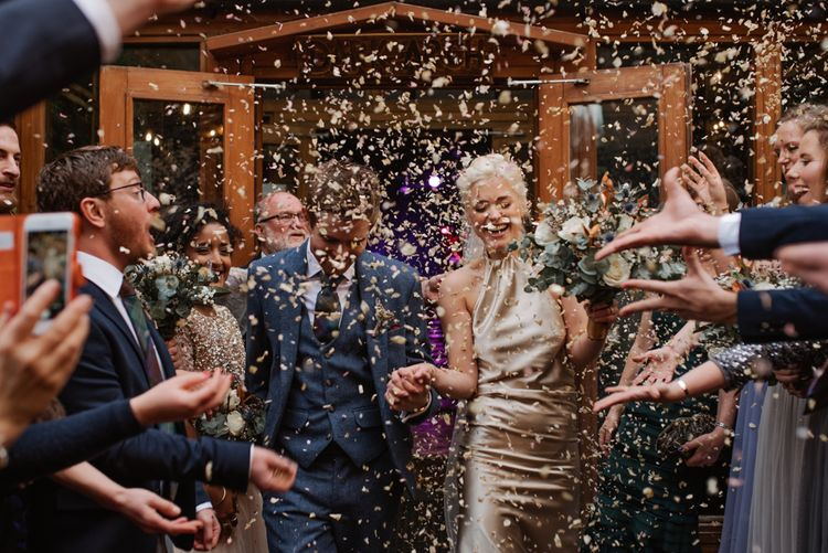 Confetti Moment // Christmas London Fields Brewery Wedding With Bride In Bespoke Dress By Katrine Mikklesen And Images From Taylor Hughes Photography