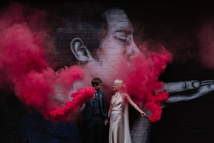 Red Smoke Bombs For Wedding // London Fields Brewery Wedding With Bride In Bespoke Dress By Katrine Mikklesen And Images From Taylor Hughes Photography