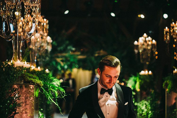 Groom at the Altar in Tuxedo | Botanical Black Tie Wedding at Rivington Hall Barn with Acrylic Candelabras & Louis Ghost Chairs | Lawson Photography | Ever After Videos