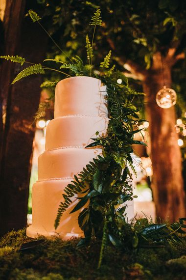 White Wedding Cake with Foliage Decor | Botanical Black Tie Wedding at Rivington Hall Barn with Acrylic Candelabras & Louis Ghost Chairs | Lawson Photography | Ever After Videos