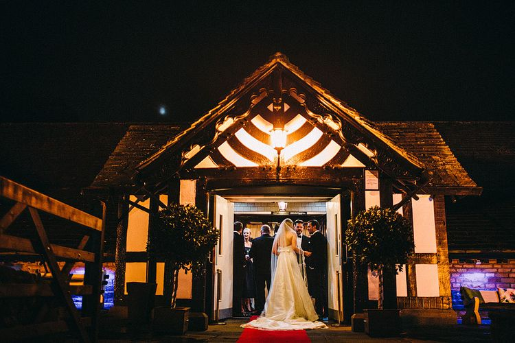 Bride in Caroline Castigliano Gown | Botanical Black Tie Wedding at Rivington Hall Barn with Acrylic Candelabras & Louis Ghost Chairs | Lawson Photography | Ever After Videos