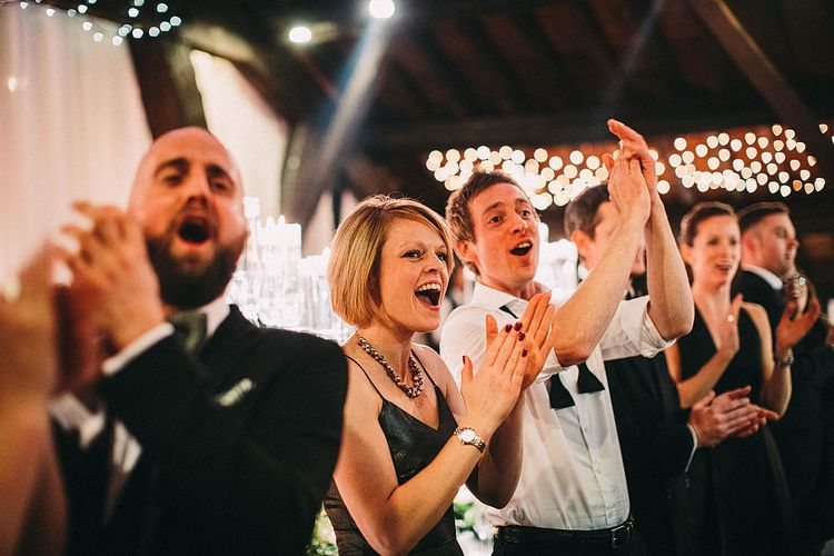 Wedding Guests | Botanical Black Tie Wedding at Rivington Hall Barn with Acrylic Candelabras & Louis Ghost Chairs | Lawson Photography | Ever After Videos