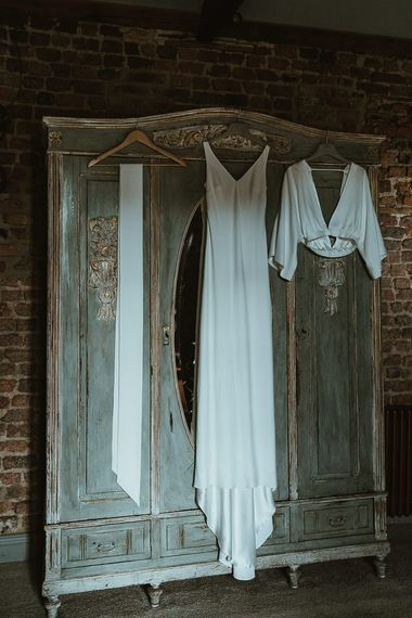 Brides three piece Charlie Brear bridal dress for winter celebration at Le Petit Chateau