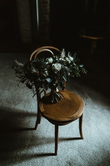 White floral and foliage bouquet for winter wedding with rustic styling