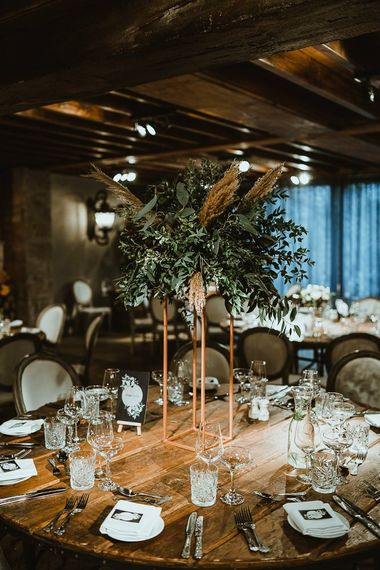 Winter reception with cosy styling and foliage table decor